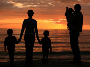 Family of 5 enjoying sunset at the seaside